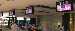 The 42-inch and 57-inch portrait displays deliver store information and special offers, while several 40-inch screens above the checkouts deliver two key messages