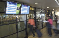 Seven million passengers see Santiago International's digital signage network yearly.