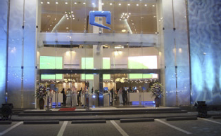 Saudi Arabias Second Mobile Service Provider Drives Growth by Providing a Better Customer Experience  The Challenge  In 2004, the Government of Saudi Arabia awarded Etihad Etisalat a license to be the second mobile GSM, 3G and 3.5G service provider in the kingdom; Mobily is the official brand name of Etihad Etisalat.  The entrance of Mobily as a second mobile operator in the biggest Gulf market has stimulated a major injection of energy and dynamism. Mobily recognizes many opportunities for growth through offering innovative services and products specifically designed for the Saudi market, in addition to introducing technologies and solutions that would give the market more dynamism and vitality. The challenge was to develop an innovative brand image that would separate them from their primary competition in the kingdom.  In January 2005, Mobily turned to PROAV, a division of United Yousef Naghi, a Scala Certified Partner, to develop an innovative digital information solution, based on Scalas Digital Signage Platform, for Mobily Mobile Outlets. The network would serve as a technology solution to enhance the brand image of the company and provide customers with information on products and services available in Mobily Mobile Outlets.  The Solution  Over the past three years, PROAV have worked as a business partner with Mobily helping them deploy in 35 Flagship Outlets, 45 Fully Branded Outlets, 182 Mini Fully Branded Outlets, and 3 Mobily Megastores. Currently, Mobily has deployed over 360 Scala Players throughout their mobile outlet network. Over the entire network Mobily delivers their product/service messages to:  -19 Full Graphics LED Screens - 1000 Plasma/LCD screens ranging from 42 to 71 - 100 Interactive kiosks - 1 Video Wall  17m X 2m - 4 Video Walls -- 4m X 3m - Rear projection system display holographs on main window of Mobily Megastores in Riyadh and Khobar  Each Mobily Megastore employs between 40 and 50 Scala Players throughout the store.  Content for the Mobily digital information network is created and managed by United Yousef Naghi from their three Network Operations Centers (NOC) in Jeddah &amp; Riyadh, Saudi Arabia. Content is distributed over an IP infrastructure to all of Mobilys Mobile Outlets.  To reduce the perception of long waiting times while a sales associate becomes available, Mobilys digital information network is integrated into the Q-Matic customer queuing system, displayed on a customized LED screen to match Mobily guidelines and sound system. As customers arrive, they interact with a kiosk or counter attendant. Customers can then wait in a central area or browse until called. When a counter becomes available, the counter attendant calls the next customer using an on-screen application, voice announcement and text LEDs. The next individual waiting receives both visual and audio notifications directing the customer to that counter.  The Benefit  In the beginning of 2008, Mobily rebranded their stores to maximize its services. Mobily found that education is a critical factor for selling Mobilys new technology platforms. To mitigate the huge customer volume the Mobily stores often encounter, the new concept was conceived to provide an area dedicated to casual, independent exploration while waiting for a consultant. This new concept is called the Knowledge Zone (K-Zone) consisting of 3 areas in a store to enhance the customer experience: Live, Play and Work.  While waiting for a consultant, customers are encouraged to wonder freely throughout the K-Zone and interact with the cutting-edge displays designed to illuminate and educate. Included in the Live, Play ad Work areas are: a Welcome Desk integrated with the Q-Matic customer management system; a self service area powered by interactive kiosks; a gaming zone for gamers; an Internet zone that provides access to the Internet; and a technical support area to assist customers with technical issues.  Mobilys overall goals to providing a better customer experience and improving the brand image of their stores has been realized. The popularity of the brand has grown in the marketplace and Mobilys customers have grown to more than 10 million, exceeding all records in the Middle East and North Africa.  Rami Badran the Director of PROAV, said that by employing strong post-sales support, building the partner relationship with the client and guiding the project with ownership spirit will ensure success. PROAV have invested heavily to support Mobily as a business partner. We have currently 3 NOCs, 1 help desk, 13 service centers over the kingdom and more than 20 vehicles to operate and maintain more than 265 Mobily outlets and management offices.