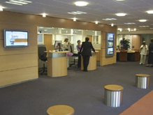 Each plasma screen would display short focused ads about the bank's varied products and services while customers waited to use the ATM machines.