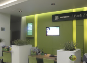 Each bank center has two screens; one displaying information about products and services and dynamic stock exchange data on the other.